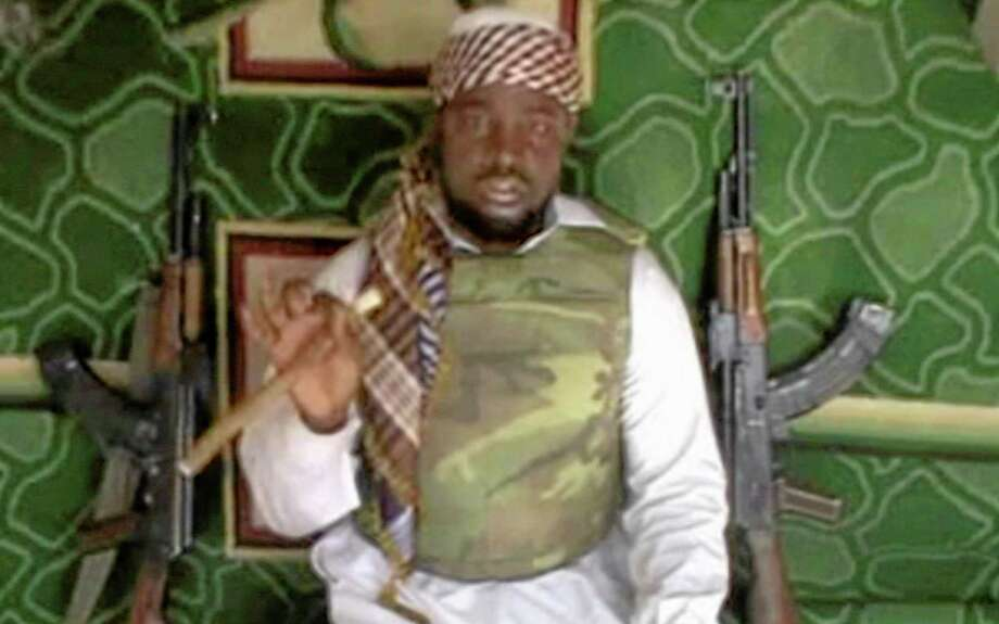 This file image made available Wednesday, Jan. 10, 2012, taken from video posted by Boko Haram sympathizers, shows the leader of the radical Islamist sect Imam Abubakar Shekau. Boko Haram has claimed responsibility for the April 15, 2014, mass abduction of nearly 300 teenage schoolgirls in northeast Nigeria. Even before the kidnapping, the U.S. government was offering up to a $7 million reward for information leading to the arrest of Shekau, whom the U.S. has labeled a specially designated global terrorist. Photo: (The Associated Press) / AP