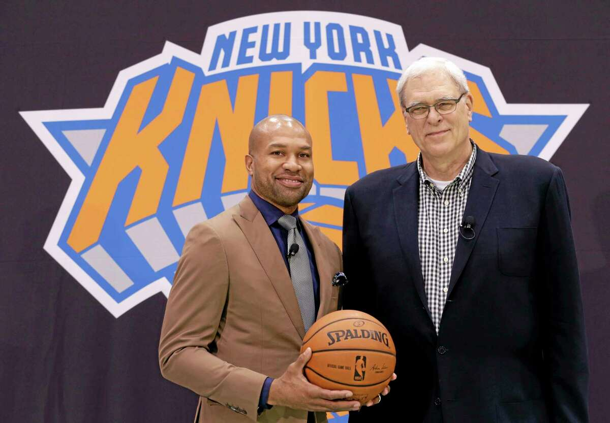 New York Knicks president Phil Jackson, right, poses with Derek Fisher during a news conference on June 10 in Tarrytown, N.Y.