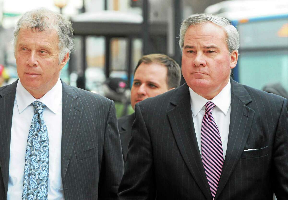 Former Connecticut Gov. John G. Rowland, right, arrives with his attorney Reid Weingarten, at the federal courthouse in New Haven in April. Rowland's trial on corruption charges began Wednesday.