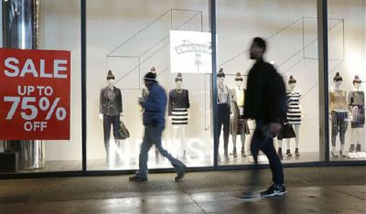 Pedestrians pass an H&M