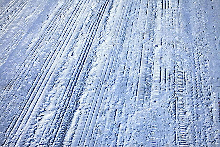 Winter Tire Tracks on Street Photo: Getty Images/iStockphoto / iStockphoto