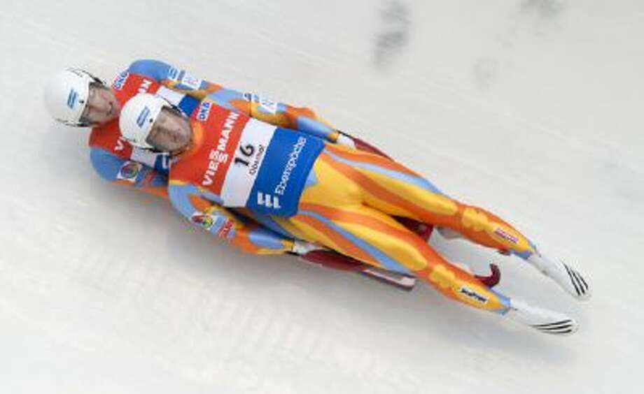 Matthew Mortensen, front, and Preston Griffall of the U.S., speed down the ice channel during the doubles at the luge World Cup in Oberhof, Germany, Jan. 11, 2014.