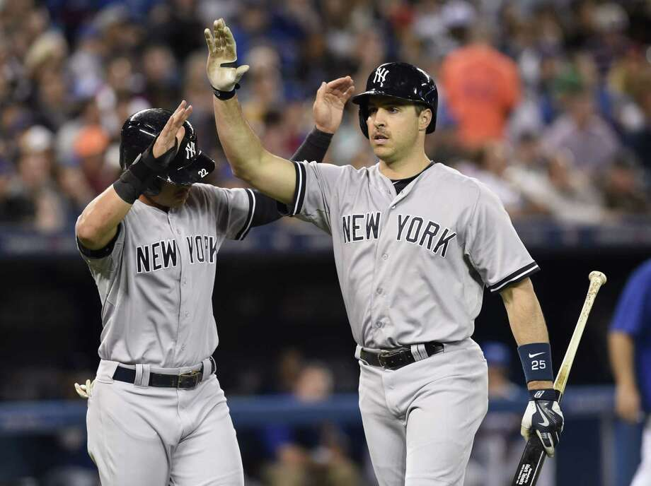The Yankees' Mark Teixeira, right, celebrates his two-run homer with teammate Jacoby Ellsbury during the fifth inning of Tuesday's game. The Yankees won 6-3. Photo: The Associated Press  / The Canadian Press