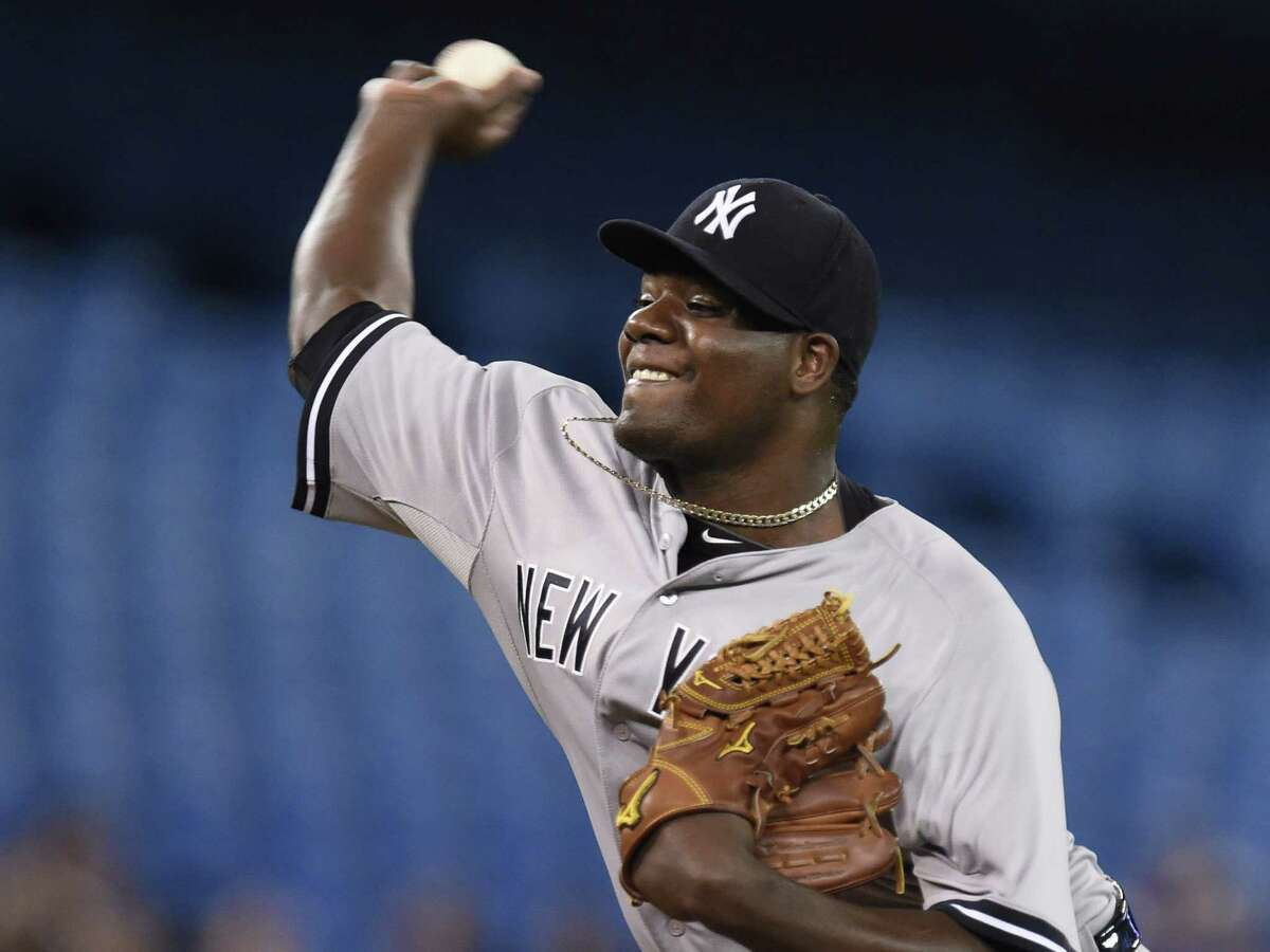 Yankees starting pitcher Michael Pineda throws against the Toronto Blue Jays during the first inning of Tuesday. Pineda hurled eight scoreless innings.