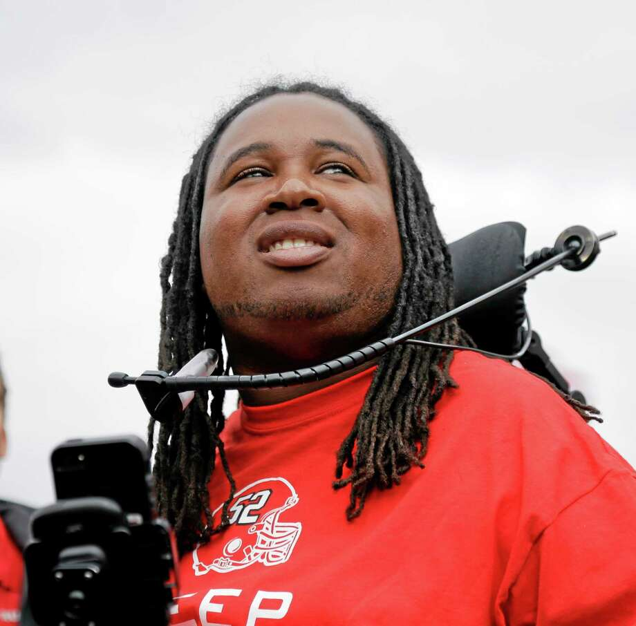 In this Sept. 14, 2013, file photo, former Rutgers football player Eric LeGrand looks up at the stands during a ceremony where his jersey No. 52 was retired at halftime of a game against Eastern Michigan in Piscataway, N.J. Photo: Mel Evans — The Associated Press File Photo  / AP