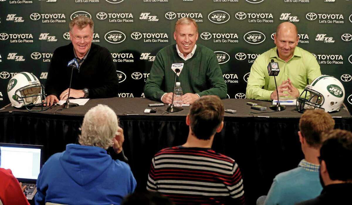 New York Jets general manager John Idzik, center, senior personnel executive Terry Bradway, left, and director of college scouting Jeff Bauer speak during a news conference on Wednesday in Florham Park, N.J.