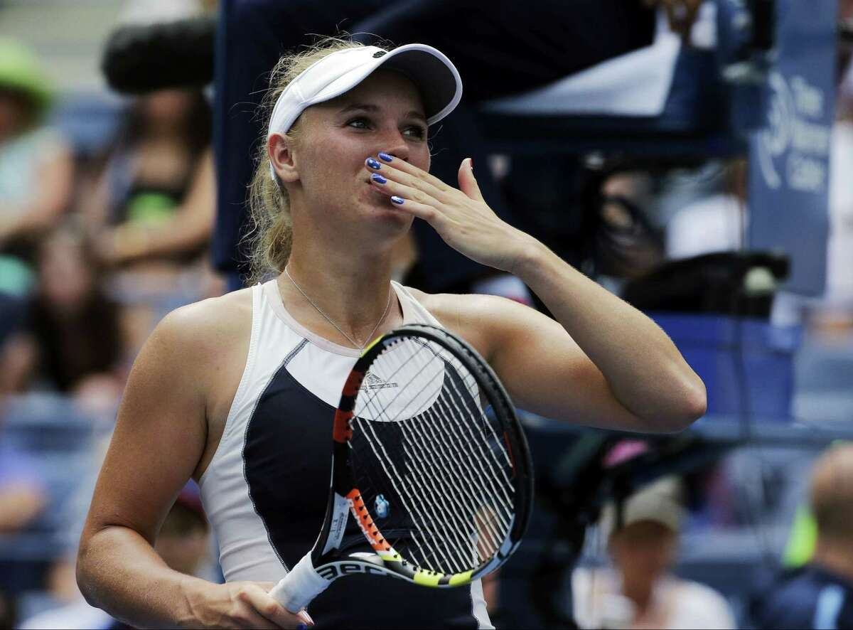 Caroline Wozniacki blows kisses to the crowd after beating Jamie Loeb during the first round of the U.S. Open on Tuesday in New York.