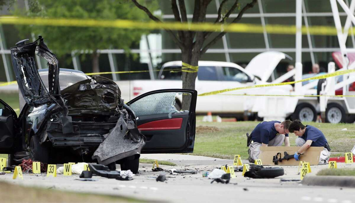 Investigators box up an assault weapon outside the Curtis Culwell Center on Monday, May 4, 2015 in Garland, Texas. Two men opened fire with assault weapons on police Sunday night who were guarding a provocative contest for Prophet Muhammed cartoons.