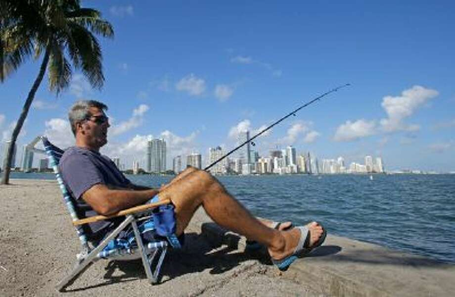 A Miami man enjoys fishing on a sunny afternoon in Key Biscayne, Fla.