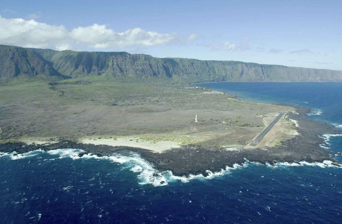 FILE -This Aug. 12, 2008, file photo, shows an aerial view of Kalaupapa Peninsula on Molokai, Hawaii. A handful of people with leprosy are still living full time on the isolated peninsula, but the National Park Service is already making plans to overhaul buildings and allow more visitors to the area when the last of the patients dies.
