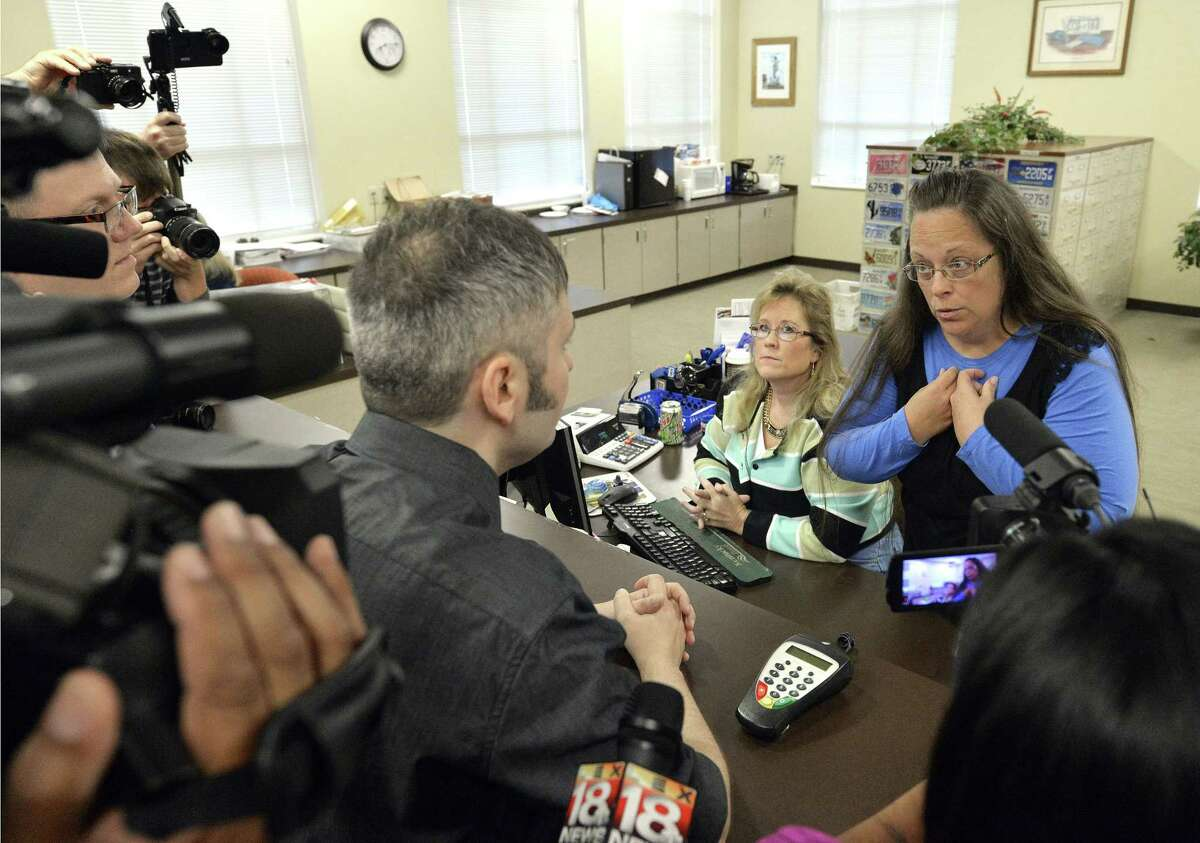 Rowan County Clerk Kim Davis, right, talks with David Moore following her office's refusal to issue marriage licenses at the Rowan County Courthouse in Morehead, Ky. on Sep. 1, 2015. Although her appeal to the U.S. Supreme Court was denied, Davis still refuses to issue marriage licenses.