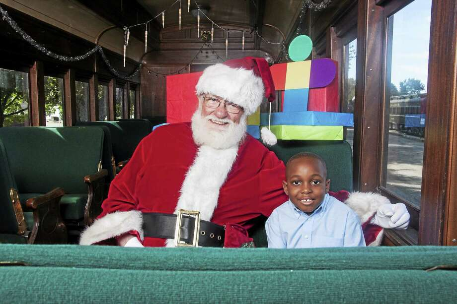 Submitted photo - CCM/Essex Steam Train Santa is joined by a young fan at the Essex Steam Train. Photo: Journal Register Co.