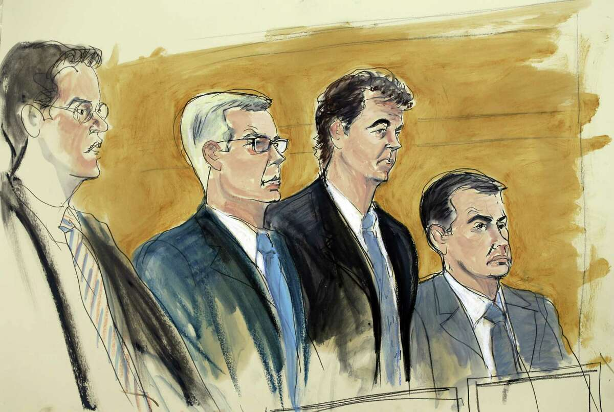 In this courtroom sketch, Alejandro Burzaco, second from right, stands with his attorneys Sean Casey, second from left, and John Couriel, right, and prosecutor Samuel Nitze, left, on July 31, 2015 in federal court in New York. The Argentinian sports marketing executive pleaded not guilty Friday in the massive racketeering and bribery case that has scandalized international soccer.