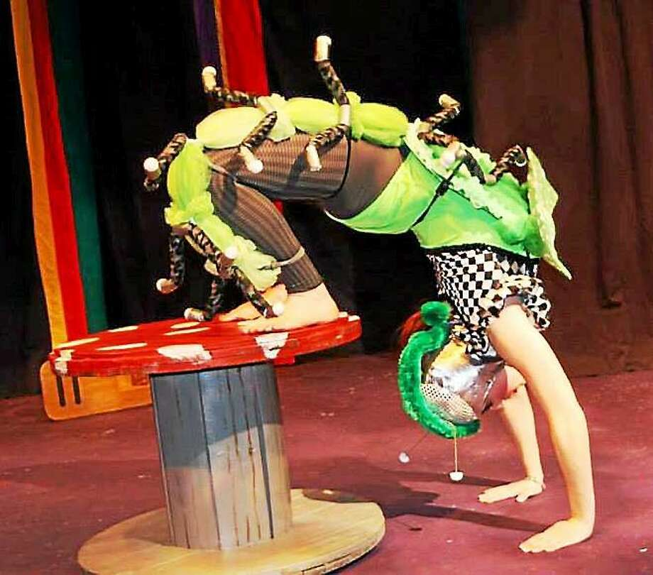 Submitted photo - Circophony Performers of all kinds between the ages of 12 and 18 are encouraged to audition for Circophony Youth Circus Company.  Auditions for the 2014-15 season will be held Tuesday, Sept. 9, 6:30 ñ 8:30 p.m. at Oddfellows Playhouse, 128 Washington Street in Middletown. Above, a performer on stage. Photo: Journal Register Co.