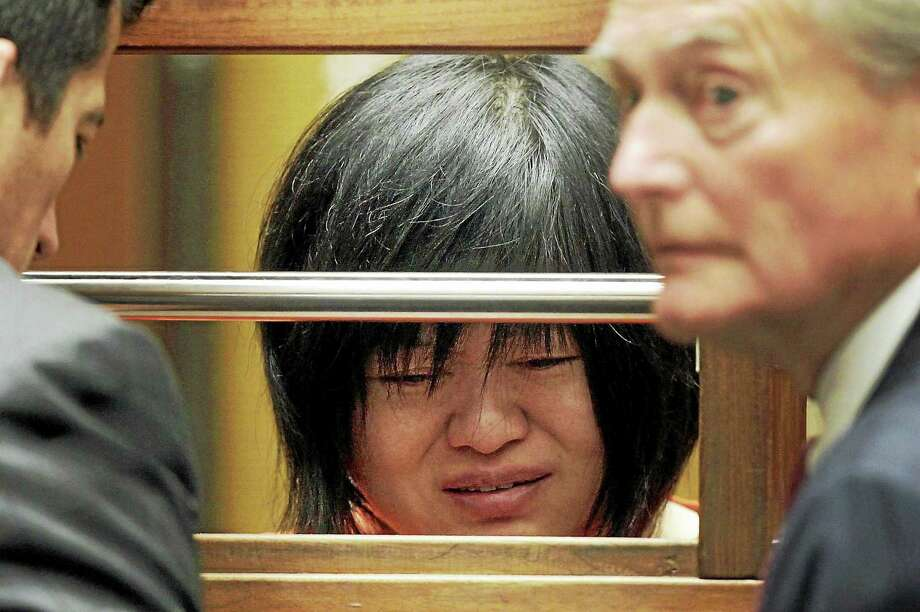 "Dr Hsiu Ying ""Lisa"" Tseng cries during her arraignment, flanked by attorneys, Edward Welbourn, left, and Alan Stokke on March 16, 2012 in Los Angeles. Tseng, a California doctor, has pleaded not guilty to charges of second-degree murder in the prescription drug overdose deaths of three patients. Photo: AP Photo/Nick Ut  / AP"