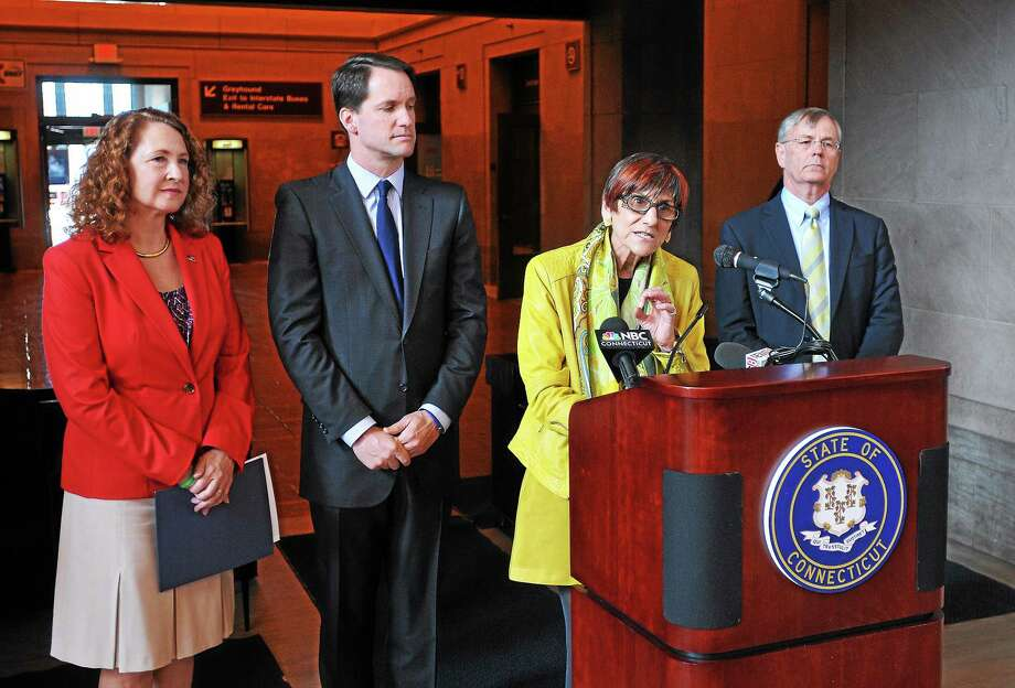 U.S. Rep. Rosa L. DeLauro, D-3, unveils a comprehensive rail safety plan at Union Station during a press conference Tuesday morning in New Haven. Behind DeLauro are U.S. Reps. Elizabeth Esty, D-5, and  Jim Himes, D-4, and DOT Commissioner James Redeker. Photo: Peter Casolino — New Haven Register