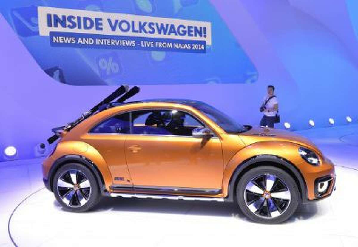 The Volkswagen Beetle Dune is presented during a press preview at the North American International Auto Show January 13, 2014 in Detroit, Michigan.