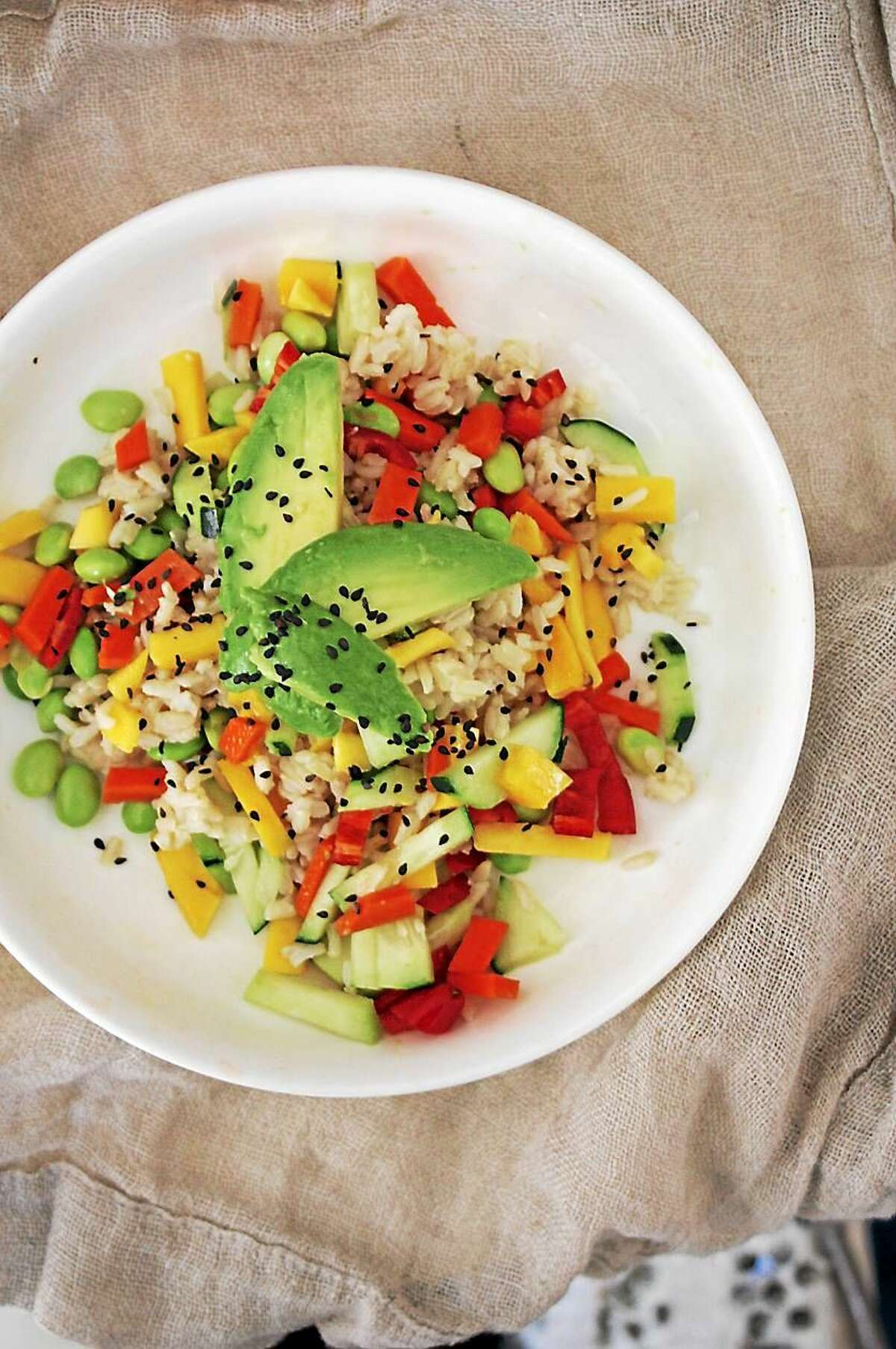 Garnished with avocado slices and black sesame seeds, the complementary textures of this Cold Grain Salad elevate an ordinary lunch to a jazzy delight.