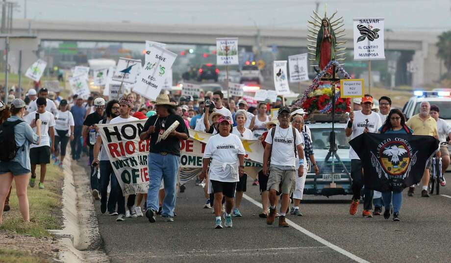 "Hundreds take part in a march and rally in opposition to the Trump administration's pursuit of a border wall in the Rio Grande Valley on Saturday, Aug. 12, 2017. They gathered at Our Lady of Guadalupe Catholic Church in Mission, Texas for a march and rally which ended at La Lomita Mission which resides behind a levy along the Rio Grande River. Organizers such as Scott Nicol from Lower Rio Grande Valley Sierra Club fears that a proposed levy wall will undermine the historic site. ""The ultimate goal (of the rally) is to show the rest of the nation that border residents reject border walls,"" Nicol said. The four-mile long march concluded as people made their way along a section of a levy leading to La Lomita Mission which was established in 1865. Oblate priests and missionaries first utilized the site as they visited Catholic churches around the Rio Grande Valley performing marriages and blessing the dead. People around the state and nation attended the march and rally according to Nicol. Among the participants was San Antonian Annette Ivy who carried a sign opposed to a wall being built at La Lomita. Ivy's brother was once a resident at La Lomita Farms - a facility that once exited on the site for developmentally disabled adults. ""It was a great facility,"" Ivy said, ""The old chapel is beautiful and it is a shame to have it cut off."" Photo: Kin Man Hui, San Antonio Express-News / ©2017 San Antonio Express-News"