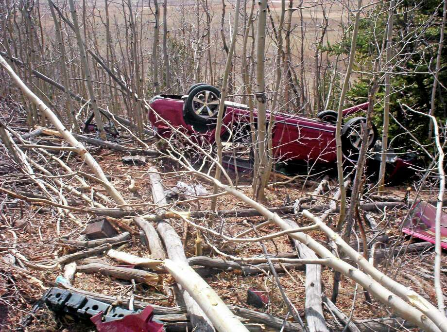 In this May 2014, photo provided by the Park County Sheriffís Office, Kristin Hopkins' car is seen after she drove off the roadway near the old mining town of Fairplay, Colo., sometime after she was last seen on April 27. Authorities say at least one motorist hiked down from Red Hill Pass on U.S. Highway 285 and alerted authorities on Sunday, May 4, that there was a body inside the car. Rescuers found Hopkins alive, conscious and coherent ó but critically injured and extremely dehydrated. (AP Photo/Park County Sheriffís Office) Photo: AP / Park County Sheriff's Office