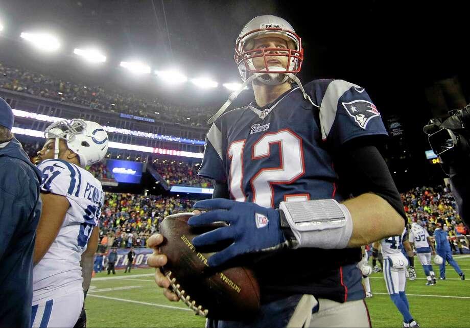 Patriots quarterback Tom Brady walks of the field after Sunday  x2019 s win  over f82ef0376