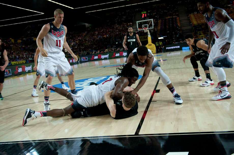 New Zealand's Thomas Abercrombie and Kenneth Faried of the U.S. battle for the ball during the Group C Basketball World Cup game on Tuesday in Bilbao, Spain. Photo: Alvaro Barrientos — The Associated Press  / AP