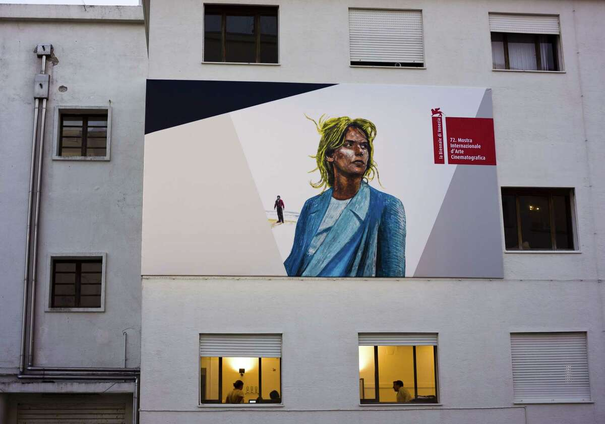 People work in the building complex hosting the Cinema Palace at the 72nd edition of the Venice Film Festival in Venice, Italy, Tuesday, Sept. 1, 2015, one day ahead of the official opening of the world's oldest film festival.