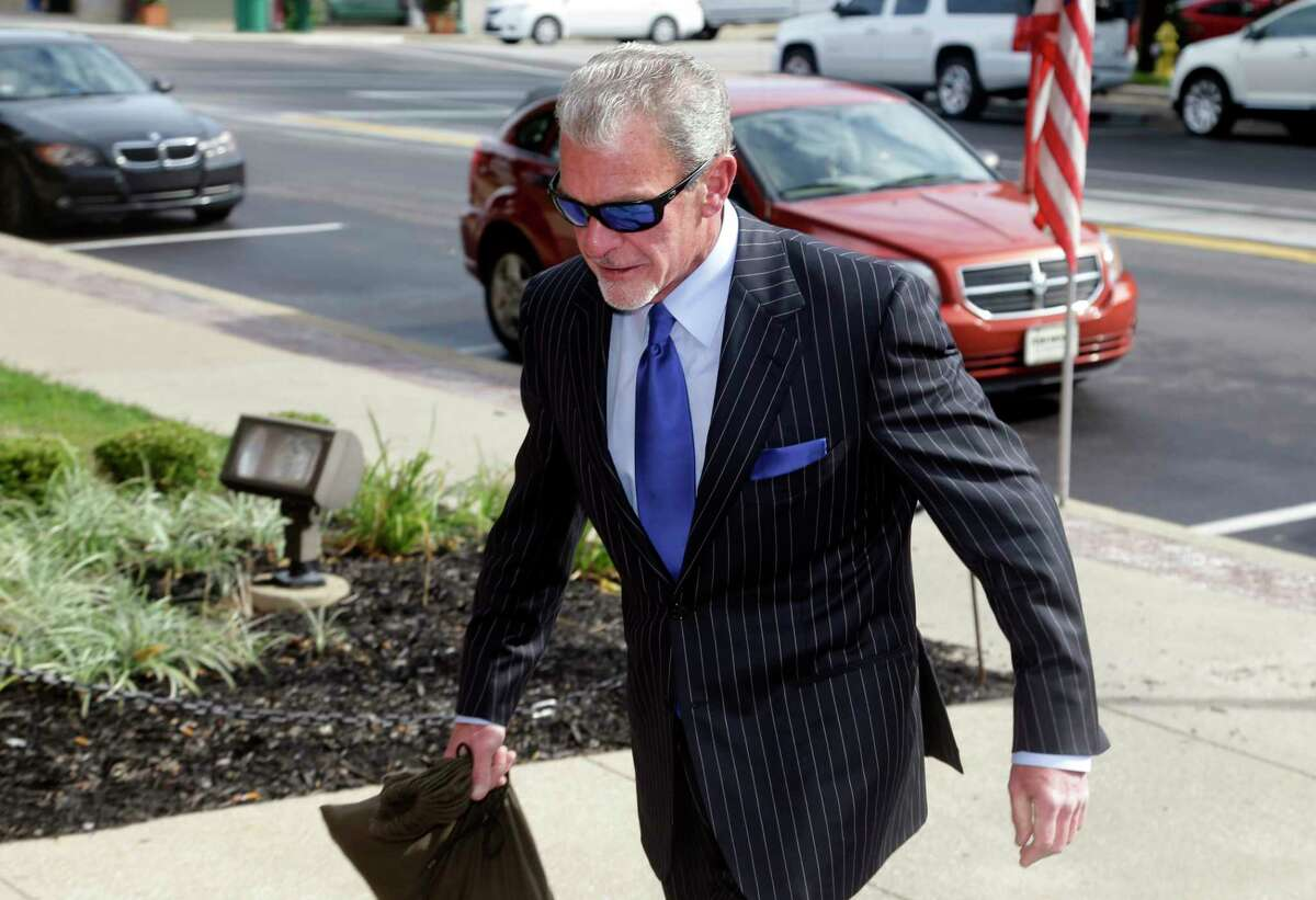Indianapolis Colts owner Jim Irsay enters Hamilton County court on Tuesday in Noblesville, Ind.