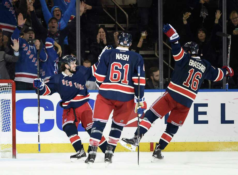 New York Rangers right wing Mats Zuccarello (36), left wing Rick Nash (61) and center Derick Brassard (16) celebrate Zuccarello's goal during the third period Friday. Photo: Kathy Kmonicek — The Associated Press  / FR170189 AP