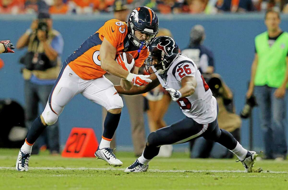 Denver Broncos wide receiver Wes Welker is hit by Houston Texans defensive back Brandon Harris (26) during the first half of a preseason game on Aug. 23 in Denver.