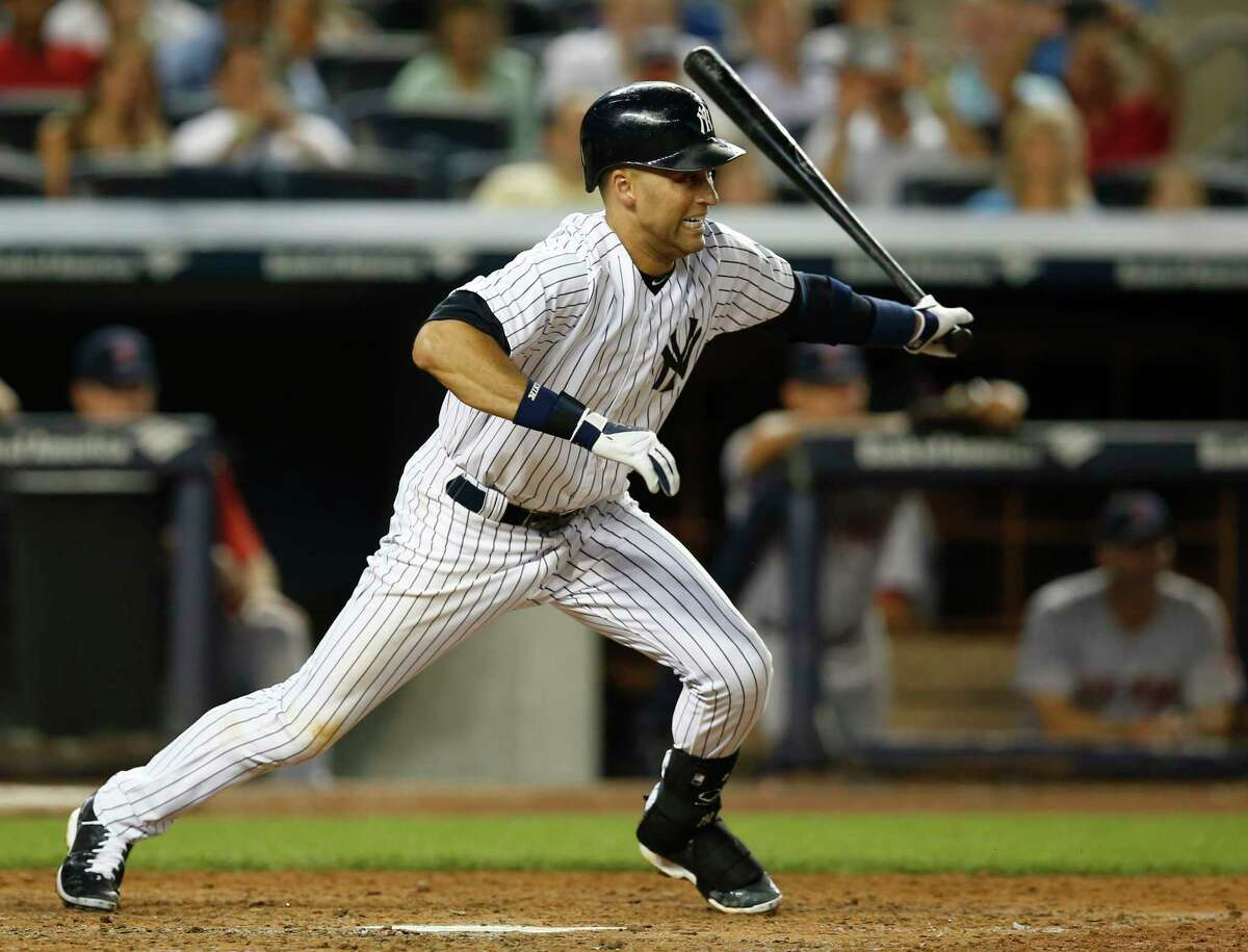 The Yankees' Derek Jeter leaves the batter's box with a fifth-inning RBI single during a game against the Boston Red Sox at Yankee Stadium in New York on Tuesday.