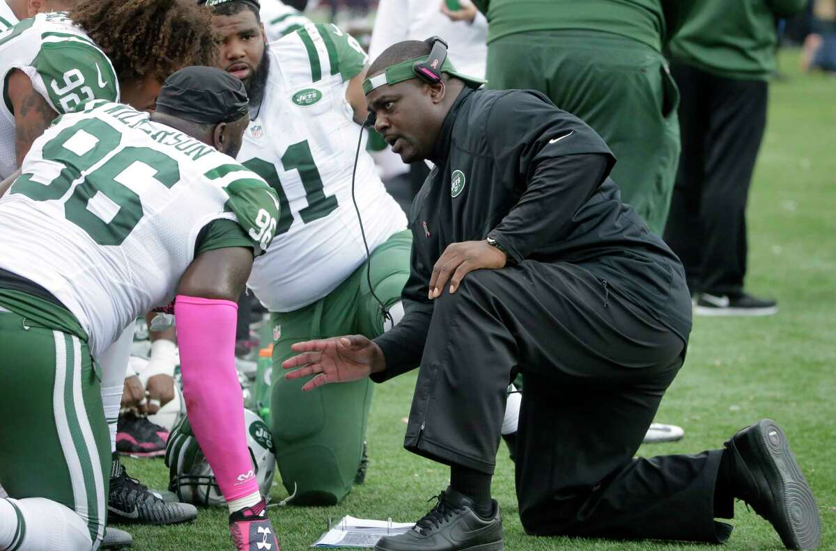 New York Jets defensive coordinator Kacy Rodgers talks to defensive end Muhammad Wilkerson (96) on the sideline during last Sunday's game against the New England Patriots in Foxborough, Mass.
