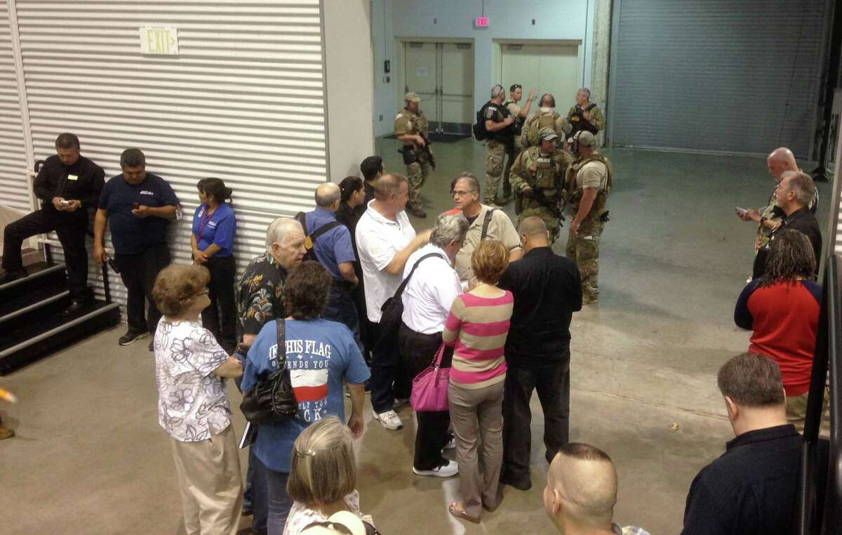 People are sequestered by members of the Garland Police Department inside the Curtis Culwell Center on May 3, 2015 in Garland, Texas. A contest for cartoons depictions of the Prophet Muhammad in the Dallas suburb is on lockdown Sunday after authorities reported a shooting outside the building.