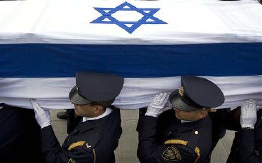 Members of the Knesset guard carry the coffin of late Israeli Prime Minister Ariel Sharon at the Knesset, Israel's Parliament, in Jerusalem on Sunday. Photo: AP / AP