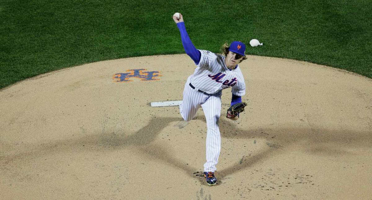 New York Mets pitcher Noah Syndergaard throws during the first inning of Game 3 of the World Series Friday night against the Kansas City Royals in Queens. Register sports columnist Chip Malafronte says regardless of your feelings about the first pitch of Game 3, you can't argue that it was a gutsy decision for a 23-year-old rookie to make.