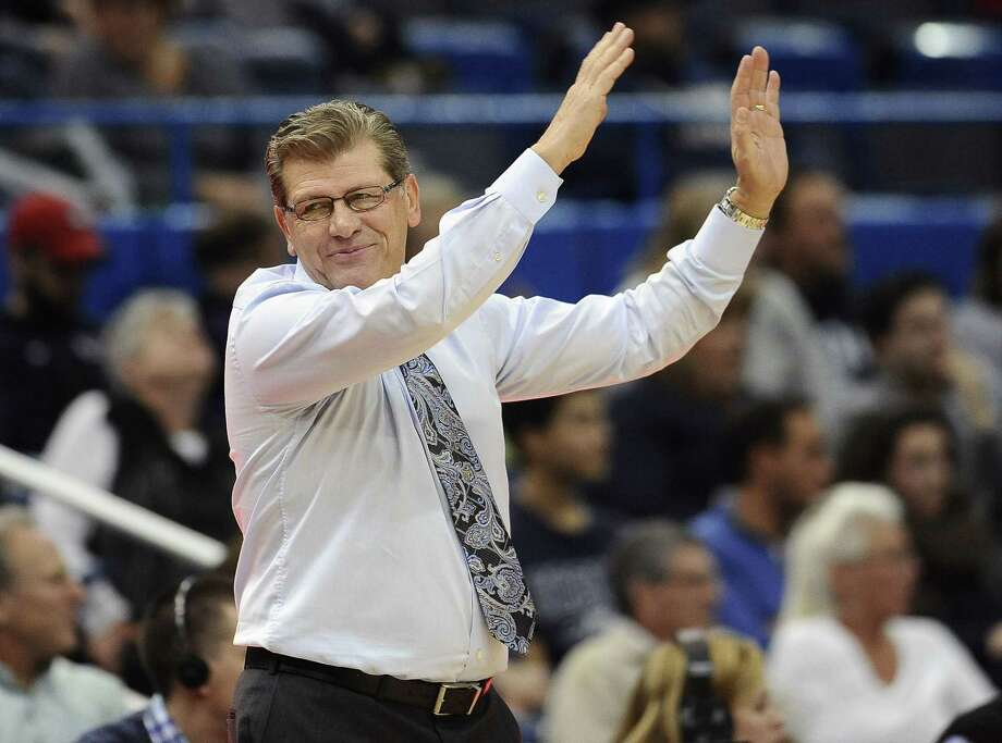 UConn coach Geno Auriemma and the Huskies will take on St. John's on Sunday. Photo: Jessica Hill — The Associated Press  / AP2014