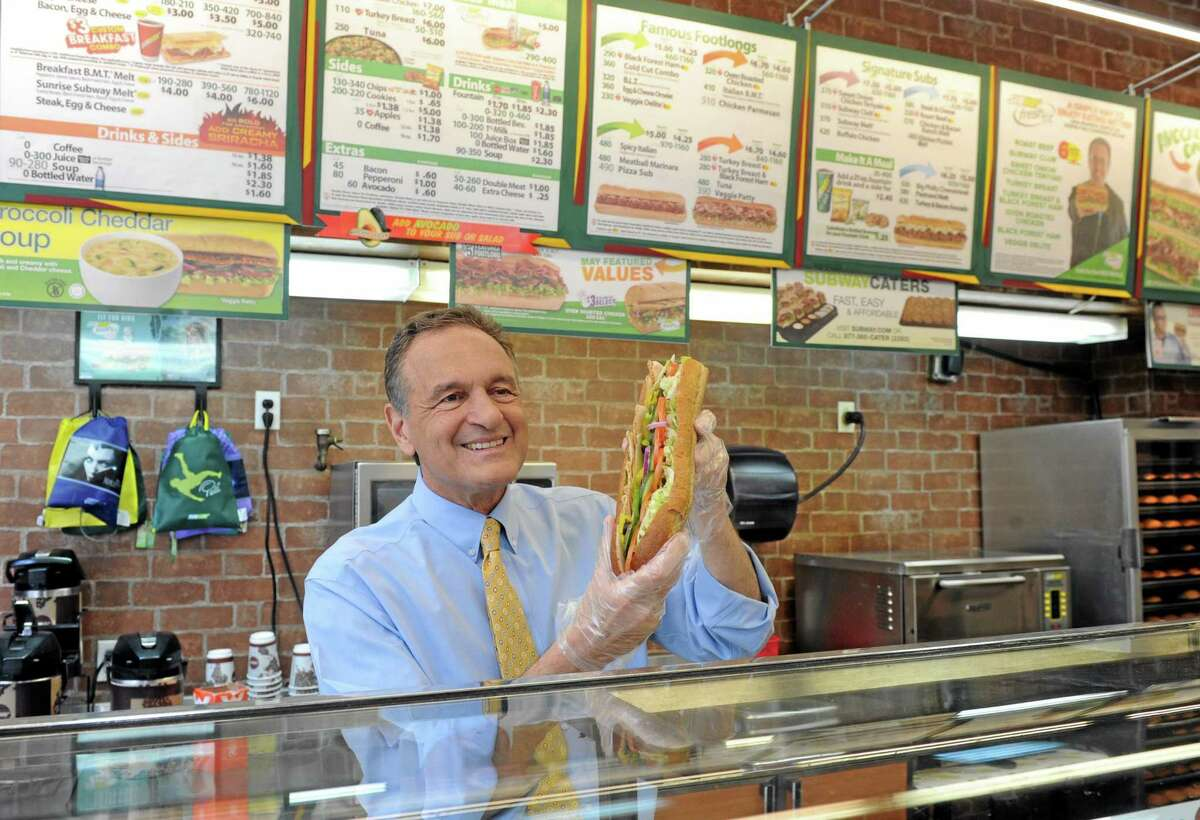 Fred DeLuca, co-founder and CEO, SUBWAY Restaurants, shows off his sandwich artistry at a SUBWAY store in New York Tuesday.