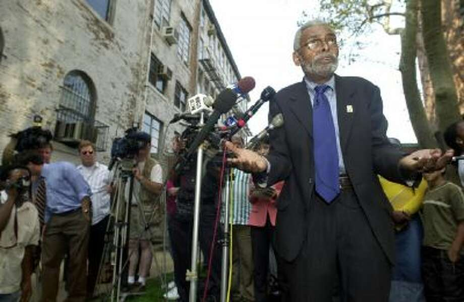 Amiri Baraka, New Jersey's poet laureate, gestures during a news conference outside the Newark Public Library in Newark, N.J., Wednesday, Oct. 2, 2002. Baraka, 68, defended a poem he wrote implying that Israel knew in advance of the Sept. 11 terrorist attacks, and again rebuffed the demand of New Jersey Gov. James E. McGreevey that he resign and apologize.