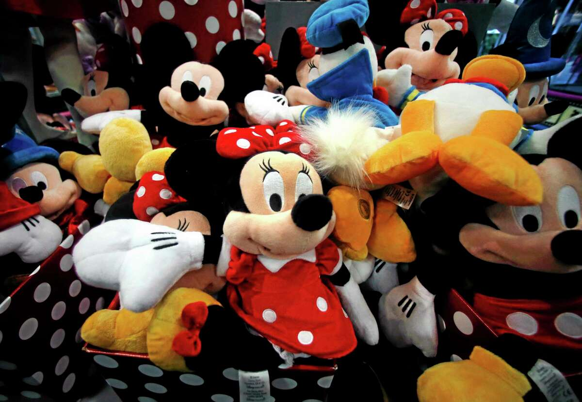 This Jan. 31 photo shows plush Disney characters piled up in a display at a Disney Store in Saugus, Massachusetts.