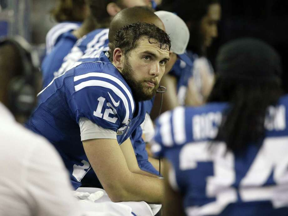 Indianapolis quarterback Andrew Luck and the Colts will take on the Cincinnati Bengals in an AFC wild card matchup. Photo: Tim Sharp — The Associated Press  / FR62992 AP
