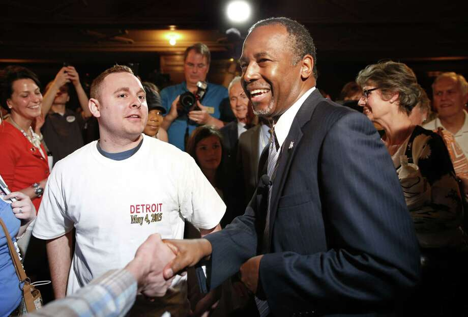Ben Carson greets supporters after announcing his candidacy for president during an official announcement in Detroit on May 4, 2015. Carson, 63, a retired neurosurgeon, begins the Republican primary as an underdog in a campaign expected to feature several seasoned politicians. Photo: AP Photo/Paul Sancya  / AP