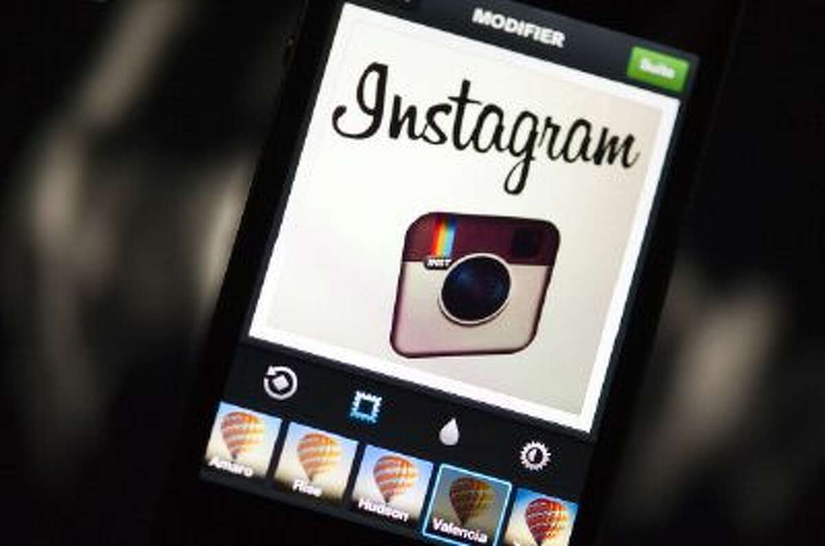 The Instagram logo is displayed on a smartphone