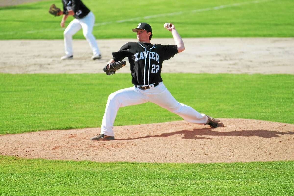 Xavier senior Sean Carroll delivers a pitch in the Falcons win over Hamden Monday at Palmer Field.