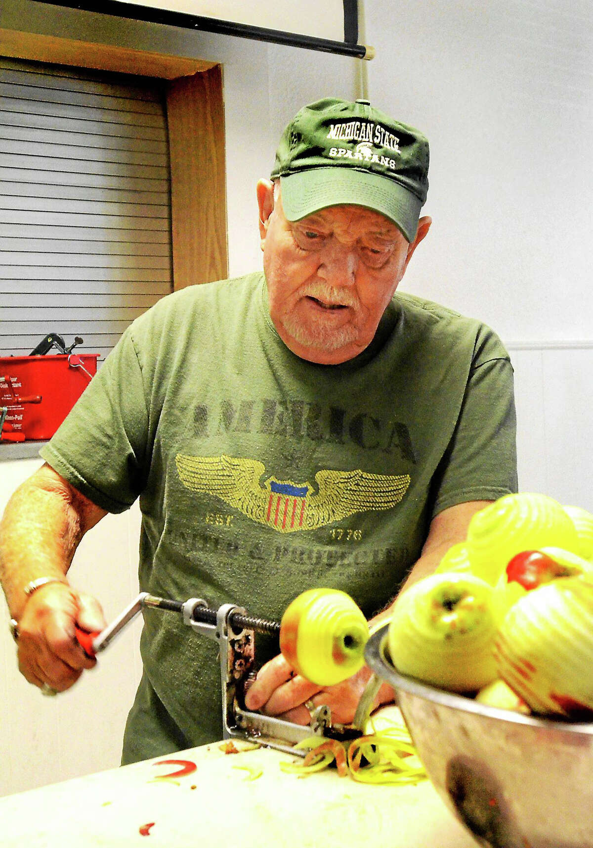 Doug Lee peels apples at the Waterford Recreation Center in Michigan in October. Volunteers created 1,200 apple pies to raise money for the Golden Age Club.