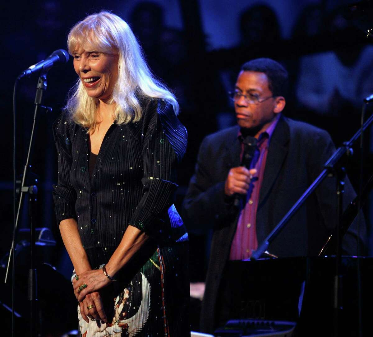 This March 20, 2008 file photo shows Joni Mitchell, left, and Herbie Hancock perform as part of Nissan Live Sets on Yahoo! Music in Los Angeles.