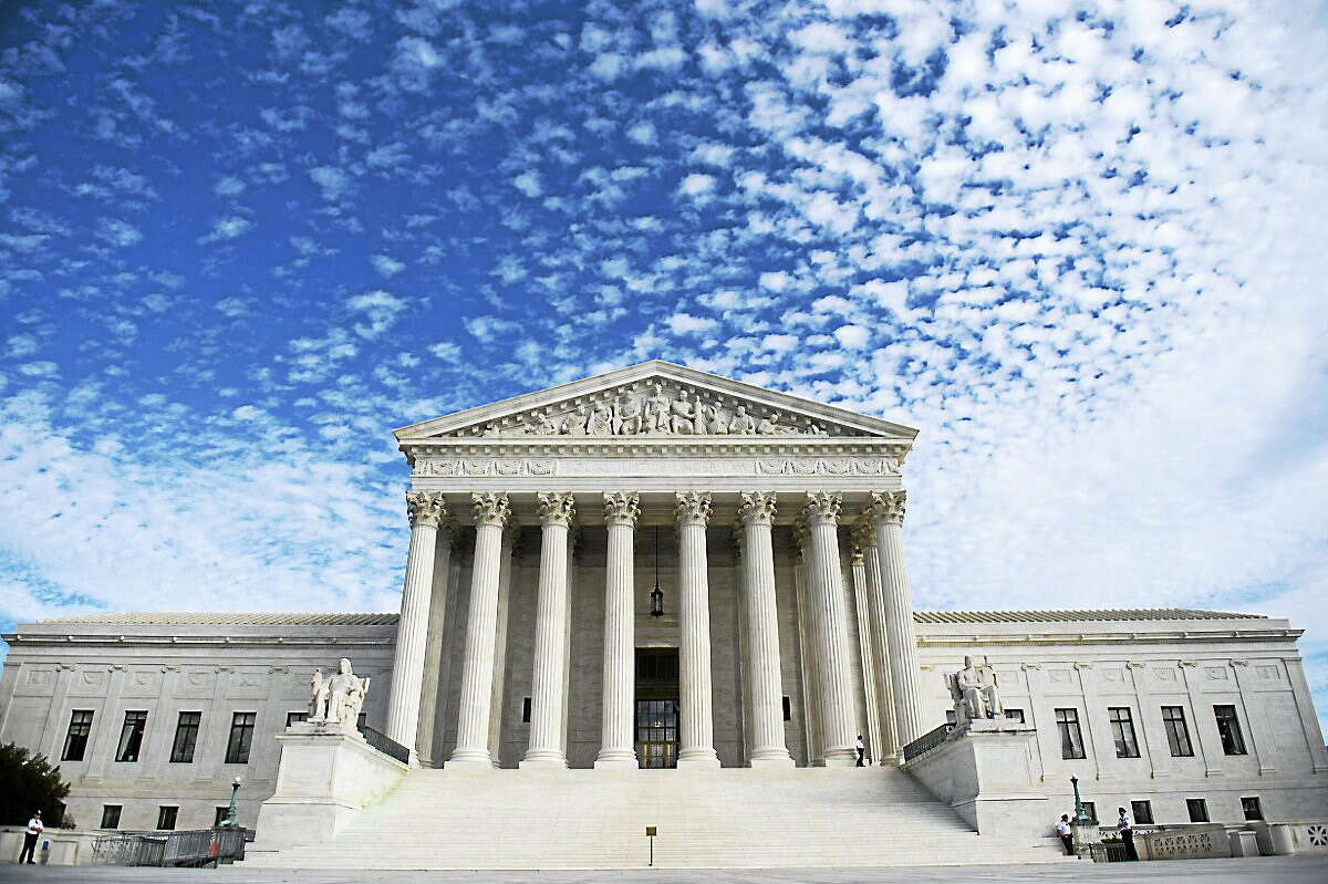 The U.S. Supreme Court in Washington, D.C. on November 6, 2013. Earlier, justices heard oral arguments in the case of Town of Greece v. Galloway, dealing with whether holding a prayer prior to the monthly public meetings in the New York town violates the Constitution by endorsing a single faith.