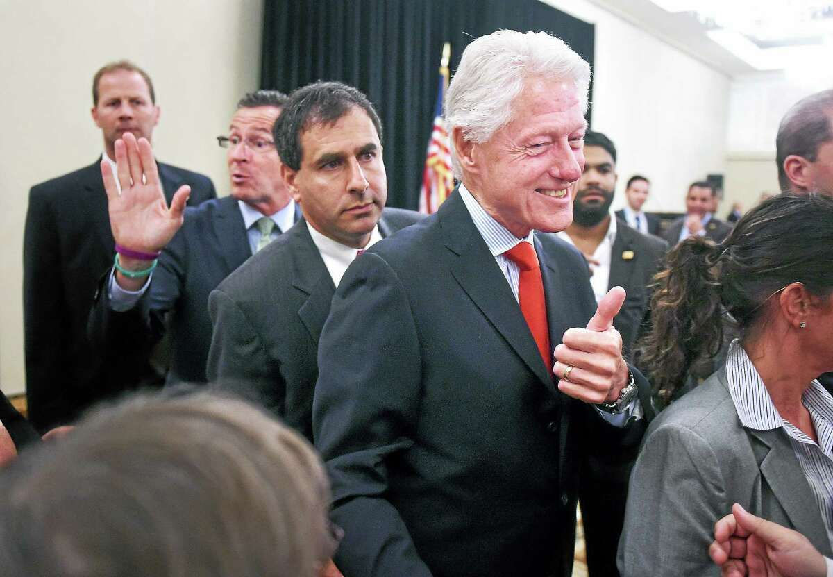 Gov. Dannel P. Malloy, left, and former President Bill Clinton, right, greet supporters at a rally at the Omni New Haven Hotel at Yale Tuesday.