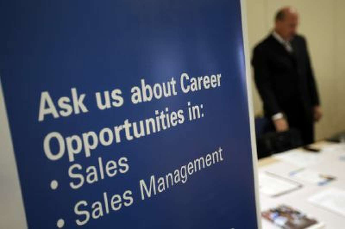 A recruiter waits to meet with job seekers at a career fair in Pennsylvania, June 2013.