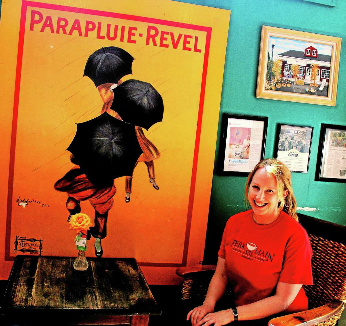 Perk On Main owner Katie Hughes relaxes in the dining area of the popular Durham eatery.