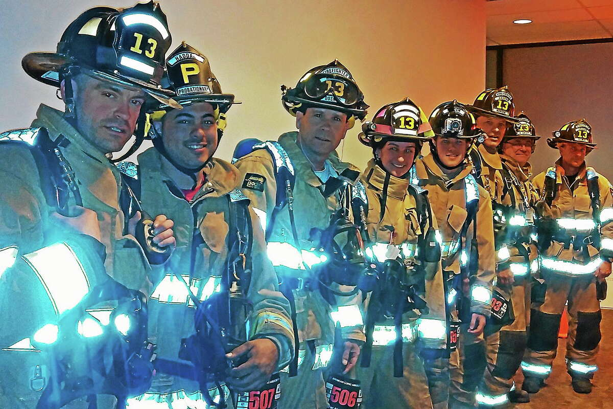 Photo by Amy Casey The Stair Climb Team, from left: Firefighters Jed Morrissey, Mike Mancuso, Jeff Doskos, Kate Zarbo, Chet Crocco, Robert Norton Jr., Dan Casey and Jay Selmer.